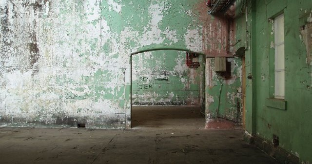 interior of an old building with peeling paint